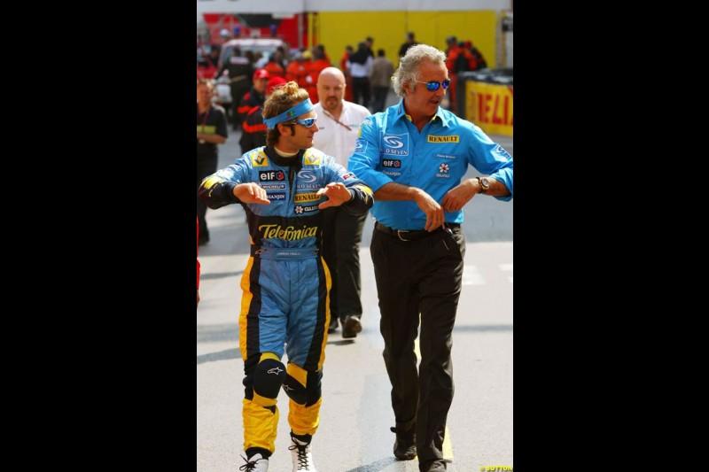 Jarno Trulli and Flavio Briatore, Monaco GP, Thursday May 20th, 2004.