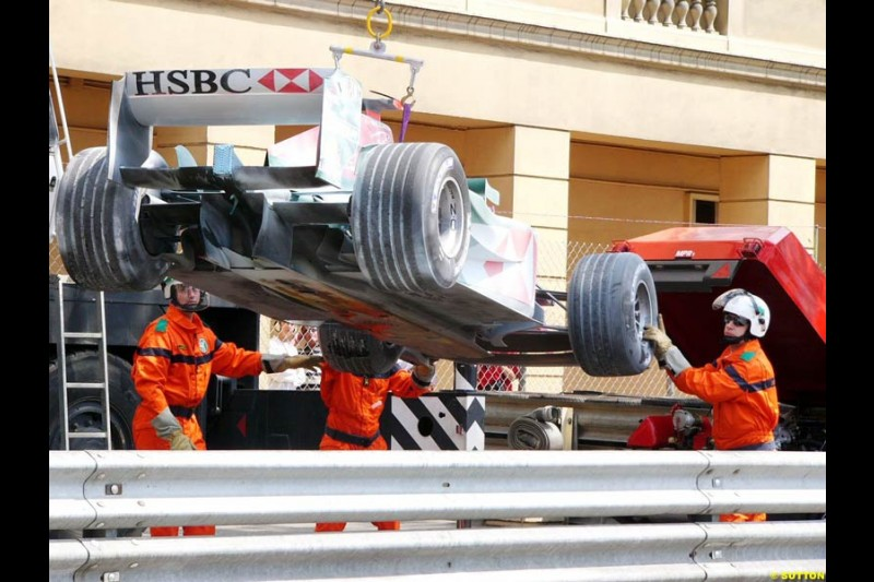 Mark Webber's Jaguar is lifted after breaking down in practice for the Monaco GP, Thursday May 20th, 2004.