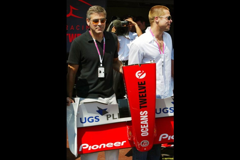 Actors George Clooney and Brad Pitt at the Monaco Grand Prix, Saturday 22nd May, 2004.