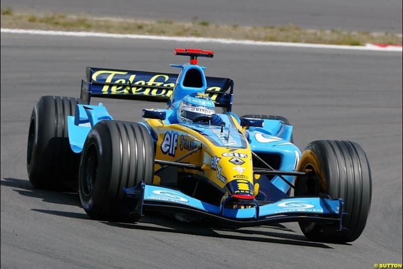 Jarno Trulli (ITA) Renault R24. Formula One World Championship, Rd 7, European Grand Prix, Nurburgring, Germany, Practice, 28 May 2004.