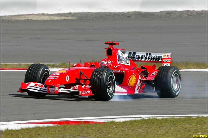 Michael Schumacher (GER) Ferrari F2004 locks up under braking. Formula One World Championship, Rd 7, European Grand Prix, Nurburgring, Germany, Practice, 28 May 2004.