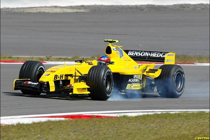 Timo Glock (GER) Jordan Test Driver locks up under braking. Formula One World Championship, Rd 7, European Grand Prix, Nurburgring, Germany, Practice, 28 May 2004.