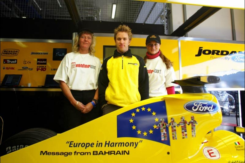 (L to R): Nick Heidfeld (GER) with the prize winning designers of the livery for the Message from Bahrain for this race, which is Europe in Harmony. Formula One World Championship, Rd 7, European Grand Prix, Nurburgring, Germany, Practice, 28 May 2004.