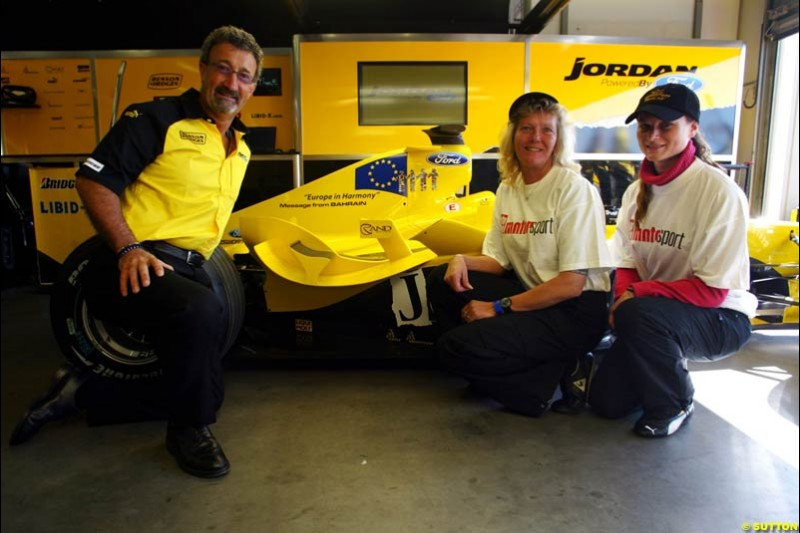 (L to R): Eddie Jordan (IRE) Jordan Team Owner with the prize winning designers of the livery for the Message from Bahrain for this race, which is Europe in Harmony. Formula One World Championship, Rd 7, European Grand Prix, Nurburgring, Germany, Practice, 28 May 2004.