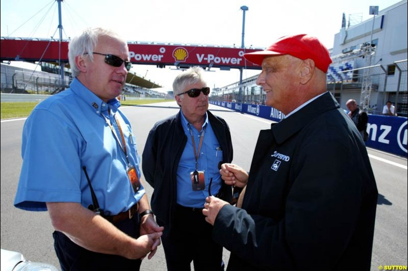 Charlie Whiting, Herbie Bash, and Niki Lauda; European GP, Saturday May 29th, 2004.