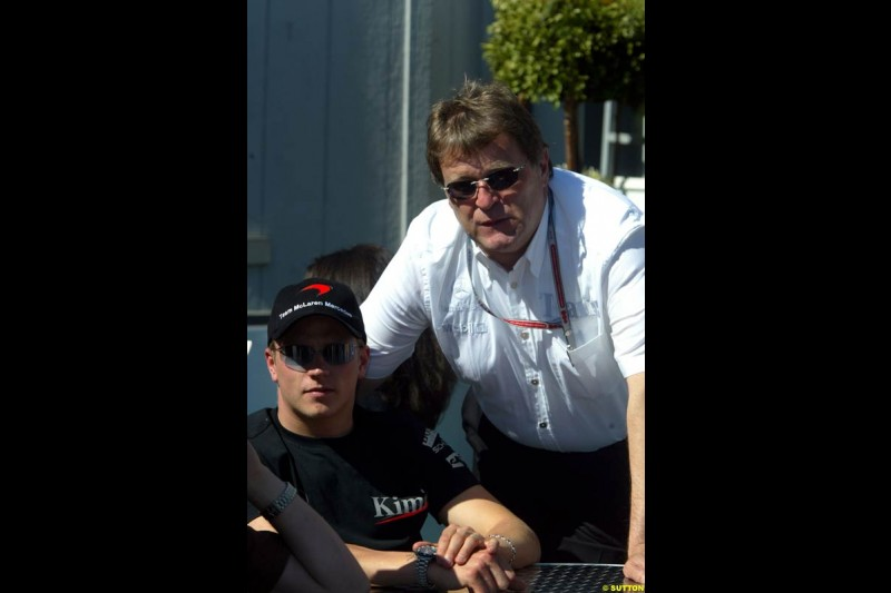 McLaren's Kimi Raikkonen with Mercedes motorsport director Norbert Haug. The Canadian Grand Prix, Montreal, Canada. Saturday, June 13th, 2004.