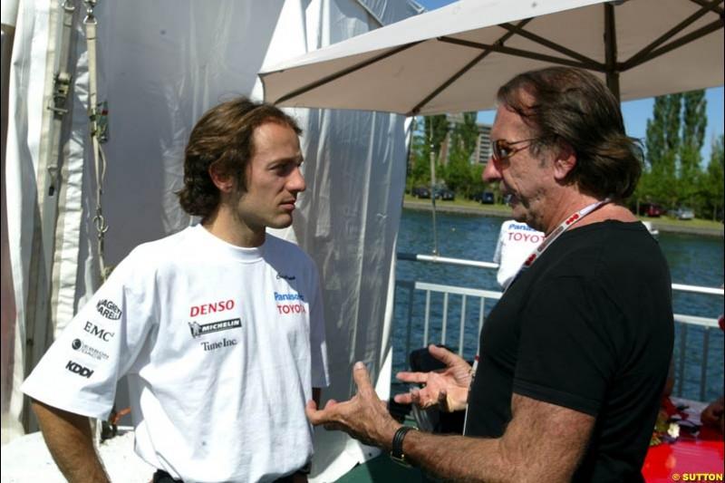 Toyota driver Cristiano da Matta chats with former World Champion Emerson Fittipaldi. The Canadian Grand Prix, Montreal, Canada. Saturday, June 13th, 2004.