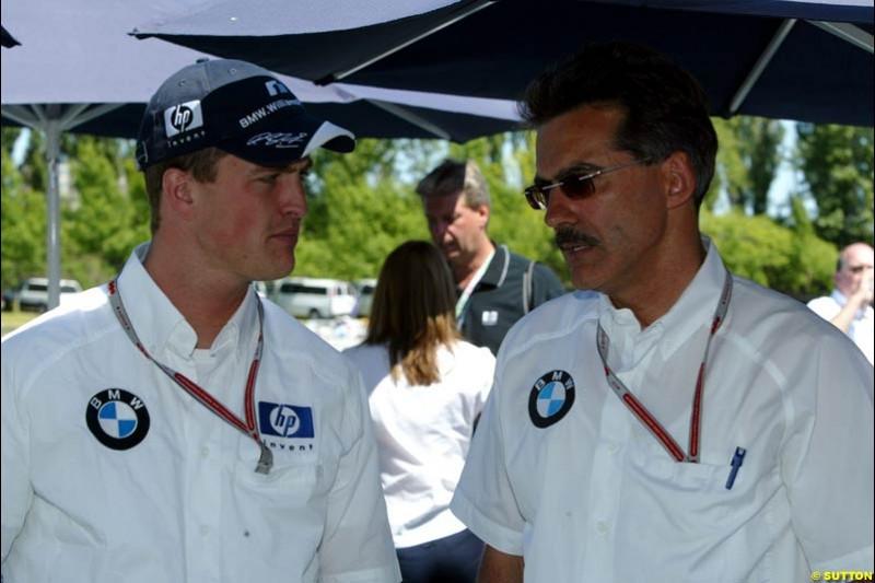 Ralf Schumacher, Williams, and BMW motorsport director Mario Theissen. The Canadian Grand Prix, Montreal, Canada. Saturday, June 13th, 2004.