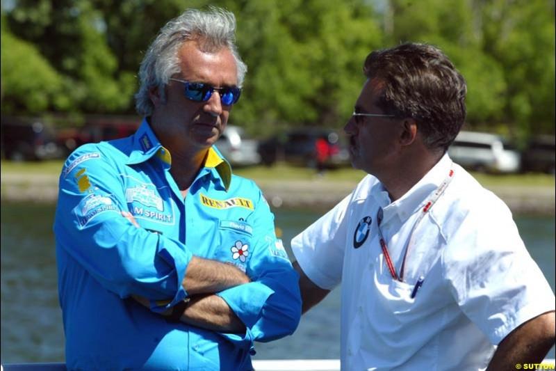 Flavio Briatore with BMW motorsport director Mario Theissen. The Canadian Grand Prix, Montreal, Canada. Saturday, June 13th, 2004.
