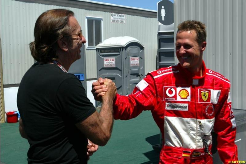 Former World Champion Emerson Fittipaldi and Michael Schumacher, Ferrari, after qualifying. The Canadian Grand Prix, Montreal, Canada. Saturday, June 13th, 2004.