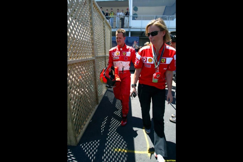 Michael Schumacher and his press officer, Sabine Kehm. The Canadian Grand Prix, Montreal, Canada. Saturday, June 13th, 2004.