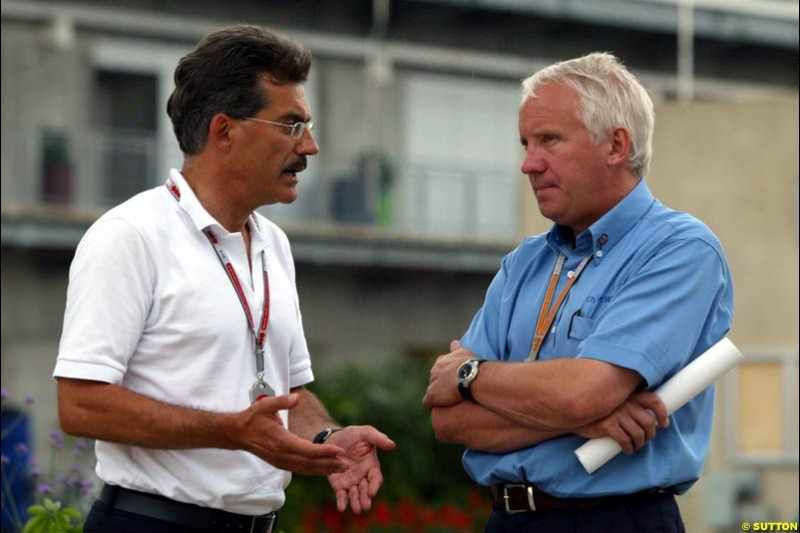 Dr Mario Thiessen and Charlie Whiting, United States GP, Thursday June 18th, 2004.