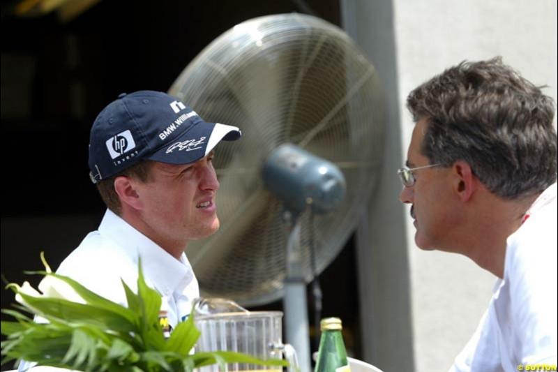 Ralf Schumacher and BMW motorsport director Mario Theissen. United States GP, Indianapolis. June 17th, 2004.