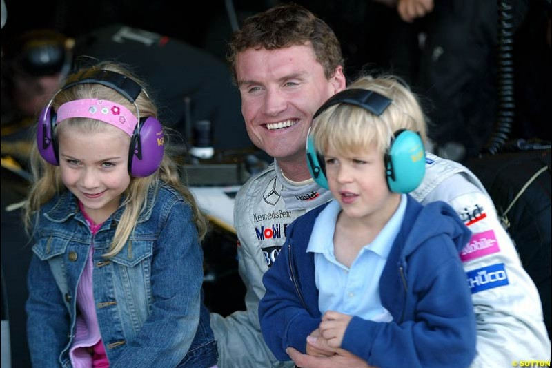 David Coulthard with the grandchildren of Sir Jackie Stewart. Silverstone testing, Wednesday July 14th, 2004.