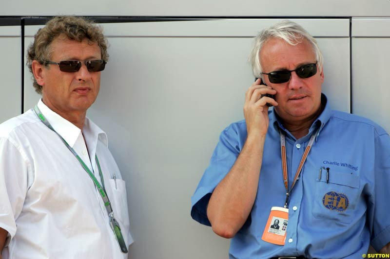 Herman Tilke and Charlie Whiting, German GP, Thursday July 22nd, 2004.