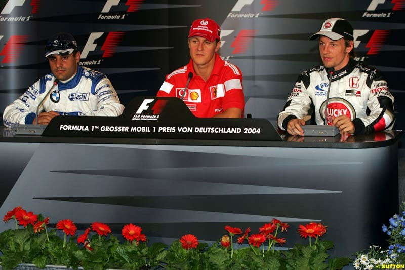 Juan Pablo Montoya, Michael Schumacher, Jenson Button; German GP, Saturday July 24th, 2004.