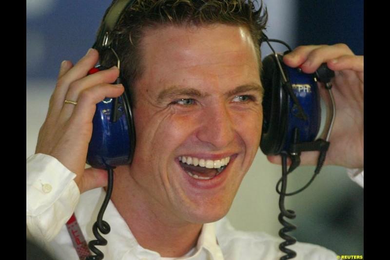 Ralf Schumacher visits the Williams pits during morning practice. German Grand Prix, Hockenheim, July 24th 2004.