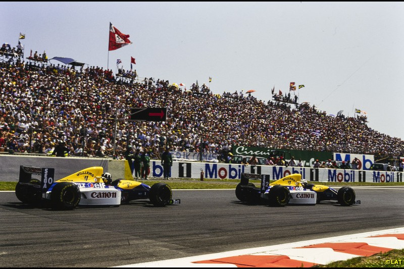 After a one-year sabbatical, Prost saw out his F1 career by securing his fourth world title - and Williams' fifth drivers' crown - in 1993. The superiority of the active ride FW15C means there is little doubt over the outcome, although Senna beats impressive newcomer Damon Hill - who wins three races in a row at the Hungaroring, Spa and Monza - to second in the standings. Prost and Hill are pictured on their way to a 1-2 finish at Magny-Cours.