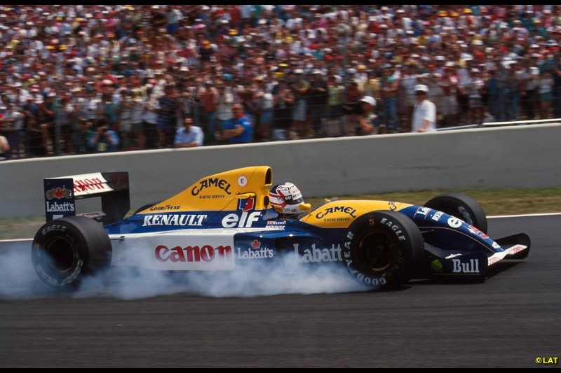 After poaching design genius Adrian Newey from March in 1990, the 1991 FW14 allowed team returnee Mansell - back after two years at Ferrari - to challenge Senna for the title. He's pictured here on his way to his first of five wins that year at Magny-Cours.