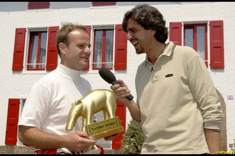 Rubens Barrichello, Ferrari receives the Golden Tapir from Italian Television, Fiorano, Italy. 17th May 2002.