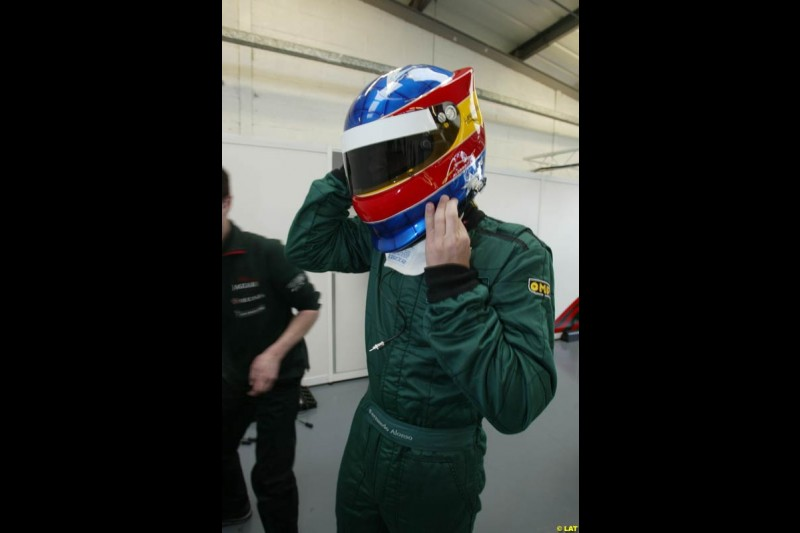 Renault test driver Fernando Alonso tries the Jaguar R3. 2002 Formula One Testing, Silverstone, England. 30th May 2002.