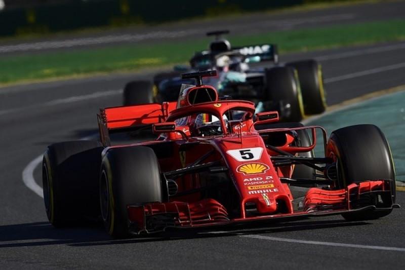 Australian Grand Prix: Sebastian Vettel jumps Lewis Hamilton to win