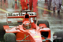 Rain master Michael Schumacher celebrating his victory