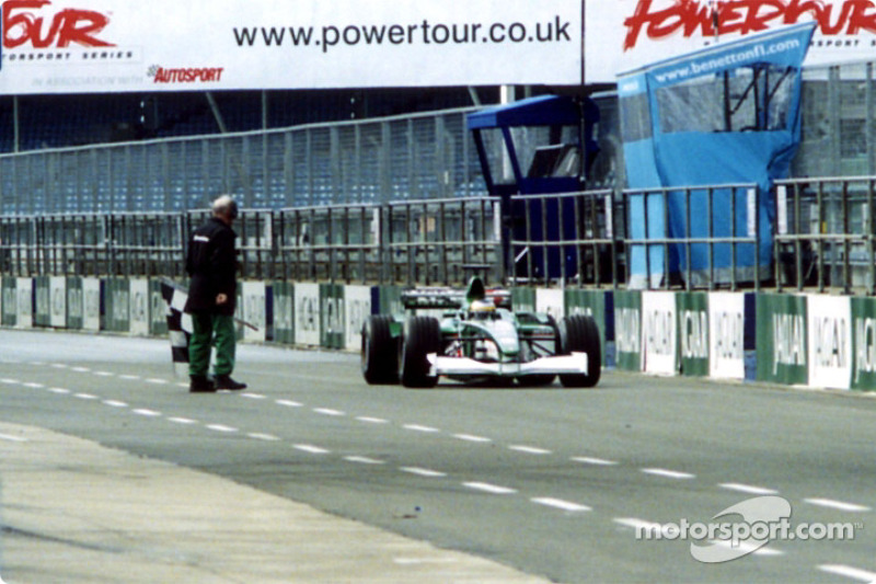 Pedro de la Rosa is warned by a marshal for staying out after chequered flag