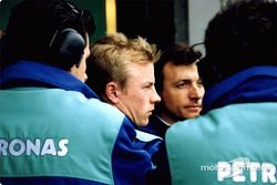 Kimi Raikonnen con su equipo