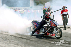 Tony Mattioli does a smoky burn-out to prepare the bike to run in Nitro Harley; Mattioli took the win