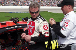 Ricky Rudd gets help putting on his neck restraint