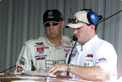 Dale Jarrett and Todd Parrott check the notebook during practice at Richmond