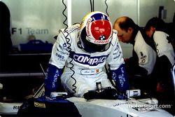 Marc Gené climbs into the cockpit