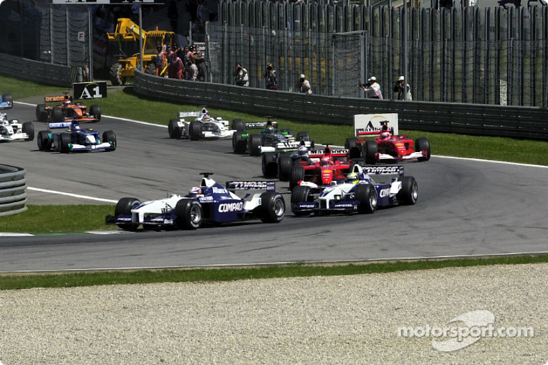 The start: Juan Pablo Montoya and Ralf Schumacher taking the first corner in front of the pack