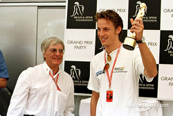 Grand Prix Party for the Brain & Spine Foundation: Jenson Button receiving his 'Bernie' award from B