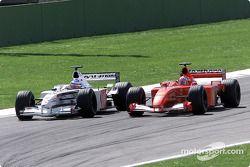 Rubens Barrichello passing Olivier Panis