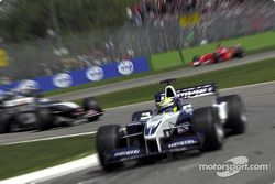 The McLaren and the Ferrari trying to catch Ralf Schumacher