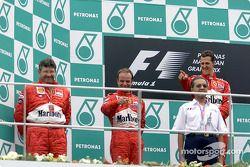 Ross Brawn, Rubens Barrichello et Michael Schumacher sur le podium