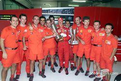 Michael Schumacher and Team Ferrari celebrating after the race