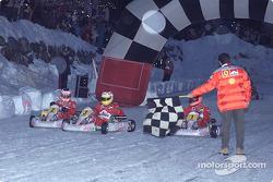 The Ferrari drivers take the chequered flag