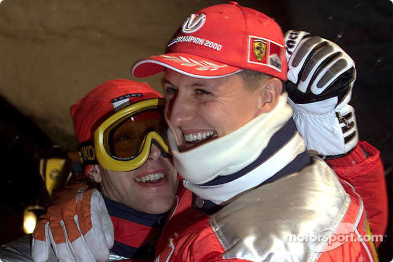 Michael hugs Ferrari'in test-driver Luca Badoer