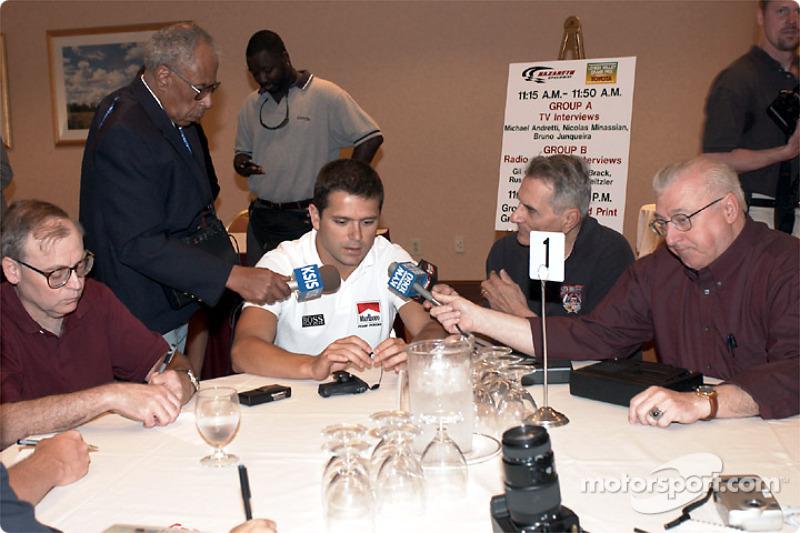 Gil de Ferran giving interviews