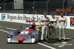 Audi drivers Frank Biela, Tom Kristensen and Emanuele Pirro with last year's victory trophy