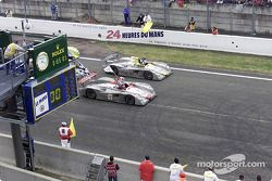 Audi celebrates a 1-2 at Le Mans: Emanuele Pirro in the Infineon Audi R8 (#1) crosses the finishing