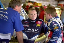 Mark Martin confers with Jeff Burton and Jimmy Fennig in the garage area