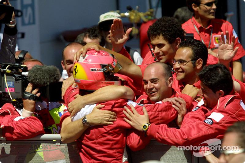 Michael Schumacher celebrating with his crew