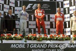 The podium: Ralf Schumacher, Michael Schumacher and Rubens Barrichello