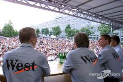 Mika Hakkinen and David Coulthard appeared on a stage in front of the Mercedes-Benz museum in Stuttg