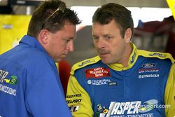 Robert Pressley compare thoughts with crew chief Ryan Pemberton