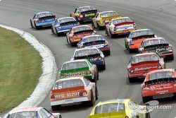 Todd Bodine and Ricky Rudd lead the field round to the green flag for the first of 200 laps around Pocono